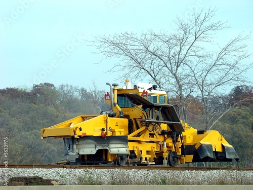 Heavy machinery repairing the train tracks