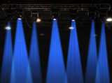 Stage lights in blue with metal rack poster