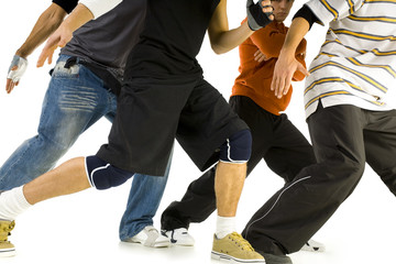 Group of young men standing in bboys pose