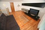 Modern furnished living room with plasma tv poster
