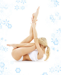 fit blond in white underwear practicing yoga with snowflakes