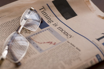 Business newspaper and glasses close-up
