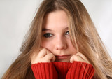 Portrait of a sad expression young woman with red pullover poster