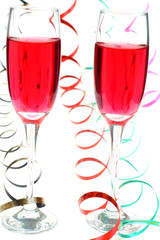 Two red party drink with streamers on white background