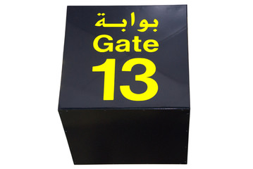 Ceiling sign of gate 13 (thirteen) in Arabic and in English