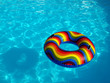 Swimming pool with a brightly coloured inflatable ring.