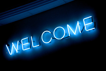 "neon ""welcome"" sign"