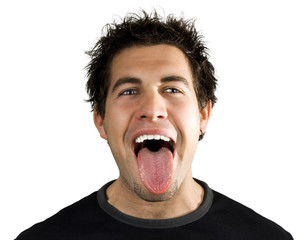 Young man screaming and smiling with his tongue out.
