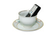 Mobile telephone in a cup..