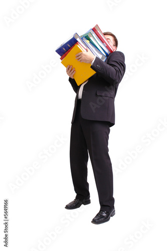 Businessman with pile of ring binders