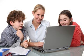 Woman with kids at the computer