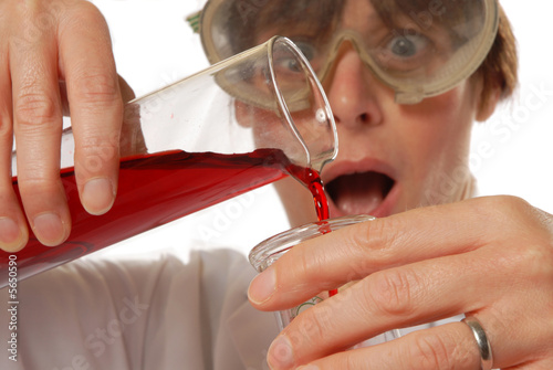 horrified lady technician pouring liquid
