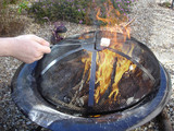 Roasting Sweet White Marshmallow above Flaming Fire Pit poster