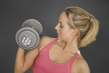 Caucasian woman in early 20s lifting weights  poster