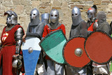 several knights on stone wall background poster