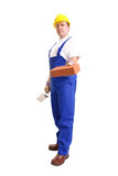 Builder in blue jumpsuit with stainless steel trowel and brick poster
