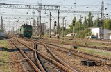 Complex railway track system with a green locomotive poster