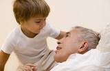 Adult senior play about with his grandson   poster