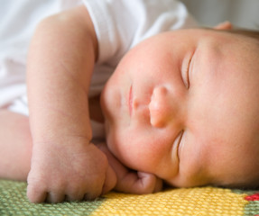 Newborn baby asleep.