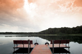 Twilight landscape with dock on small lake poster