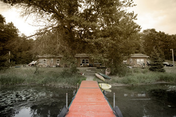 Summer vacation cabins by a small lake in the woods
