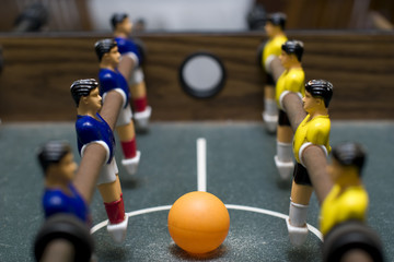 foosball game close up side view