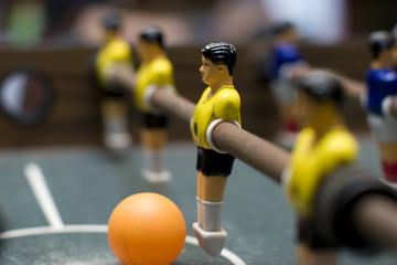 foosball game yellow team close up