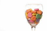 Conversation hearts in a wine glass. Concept of love. poster