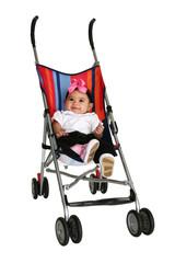 Happy baby girl in stroller over white background. Full body.