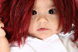 Baby girl in red shag wig. poster