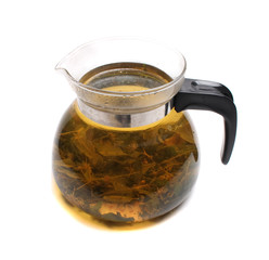 herbal tea in the teapot on the white background