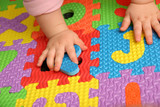 Fototapety child playing multi colored alphabet puzzle