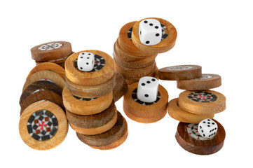 Handmade backgammon chips and playing dice.