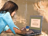 Woman doing an online credit card payment outdoors poster
