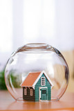Conceptual view of protecting a house - real estate insurance poster