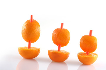 boats of mandarins on brights background