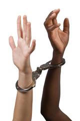 Mixed race hands Caucasian African American, handcuffs