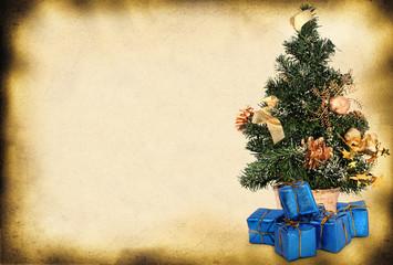 christmas tree and presents against old paper page