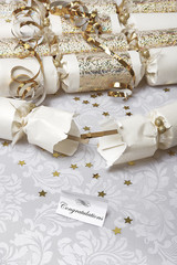 Festive party crackers with a Congratulations note