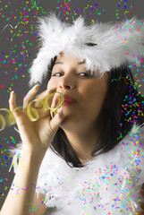 a beautiful young girl in white carnival mask blowing a ribbon