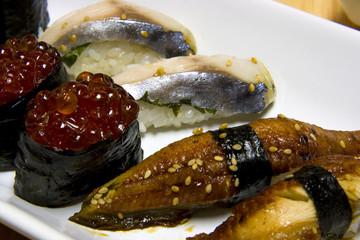 White plate full of japanese food.