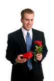 A handsome young man holding a rose
