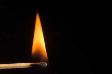 Image of a wooden kitchen match as it burns.