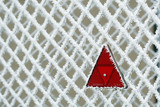 Frosty fence with red triangle - winter texture poster