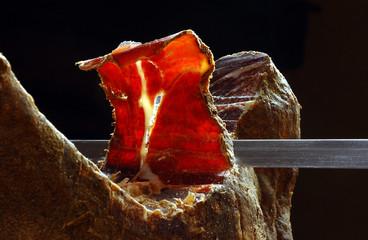 Prosciutto on holder, cutting process