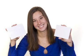 Attractive woman holding up two postcards showing a choice