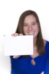 female holding a blank notecard forward