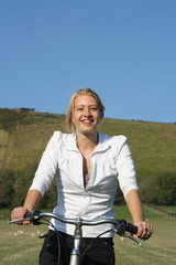 Young woman cycling.