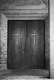 Religion concept - cross on spooky church door poster