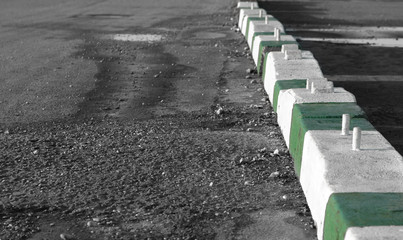 concrete diversion barriers in parking lot